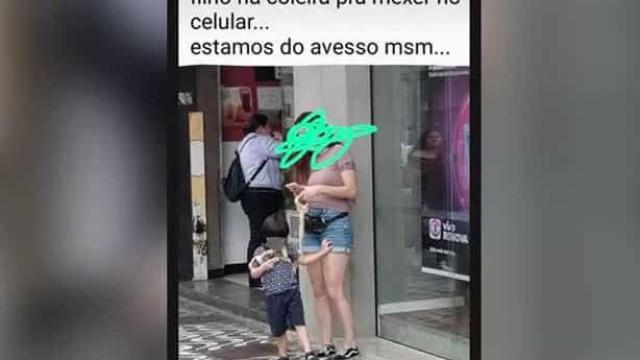 Fotografia de mãe ao telefone com filho preso por 'coleira' gera polémica