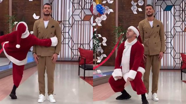 Vestido de Pai Natal, Flávio Furtado faz dança sensual para Ruben Rua