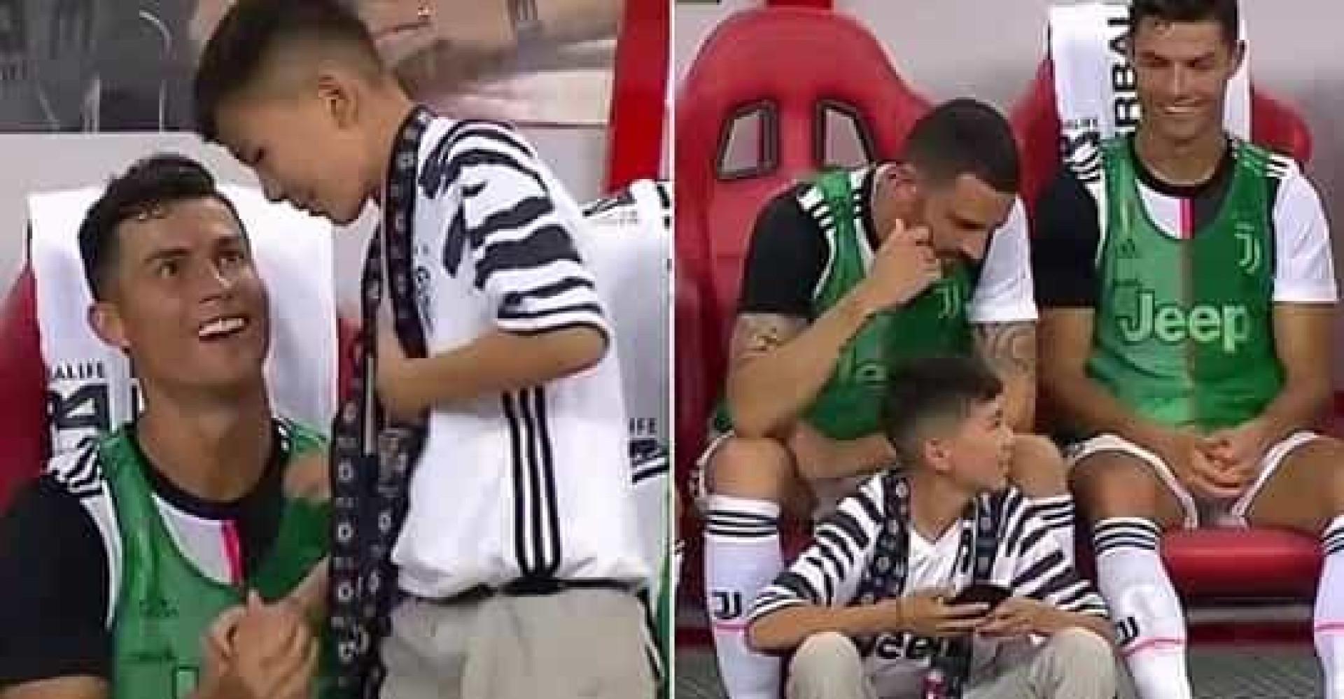 Pequeno adepto foi cumprimentar CR7 e acabou sentado no banco da Juventus