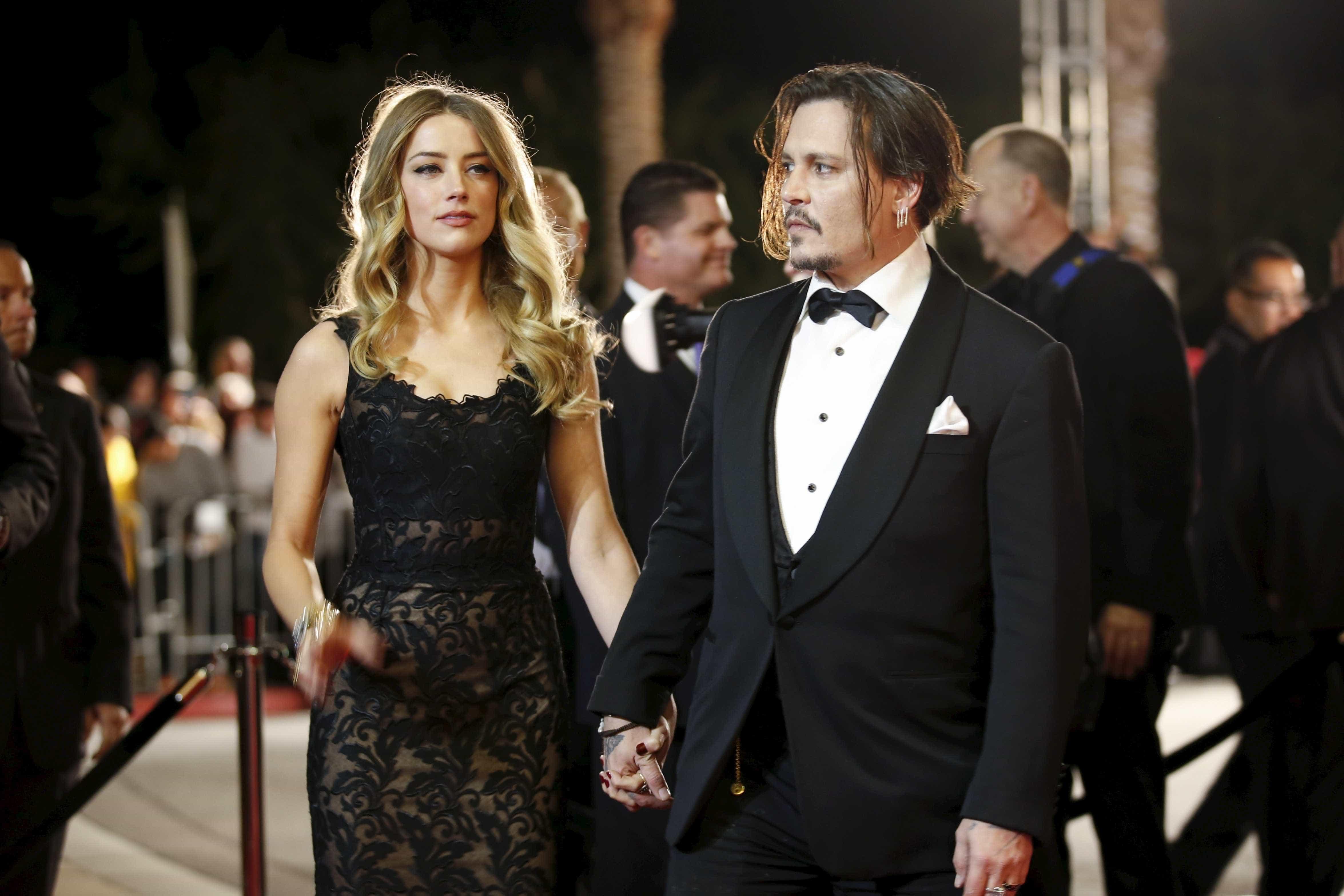 Johnny Depp acusa Amber Heard de agressão e mostra hematomas em imagem